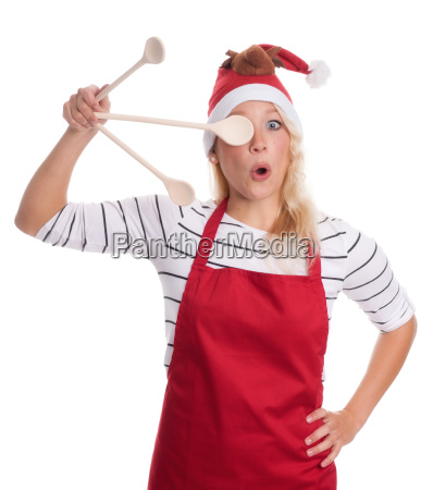 christmas woman in apron holds wooden
