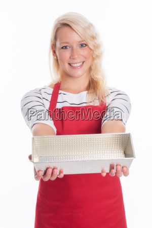 housewife in apron holding a cake