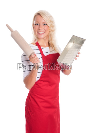 young woman holding a baking pan