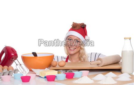 frau, mit, weihnachtsmütze, backt, muffins - 14882297