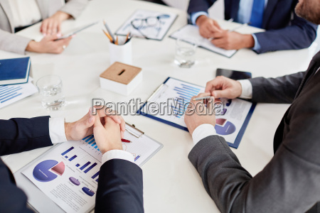 hands over business document