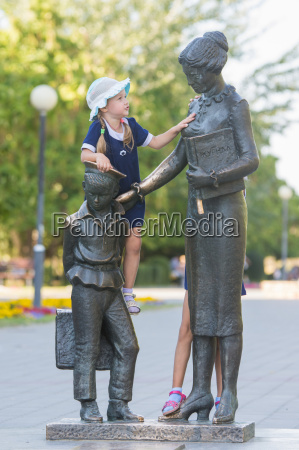 the girl climbed on the monument