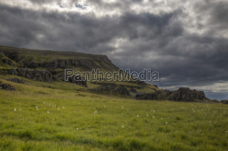 mountain meadow and storm