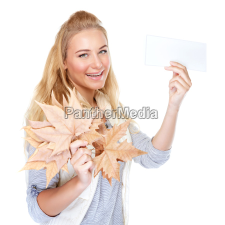 cheerful girl with dry maple leaves
