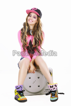 young woman in baseball cap and