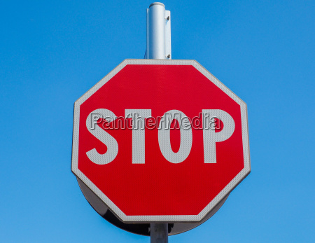 stop sign over blue sky