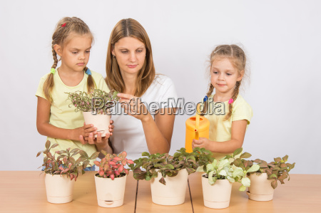 mother and daughter consider and watering