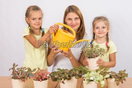 mother and two daughters caring for