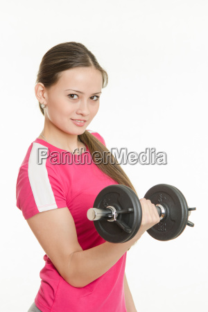 beautiful athlete dumbbell in right hand