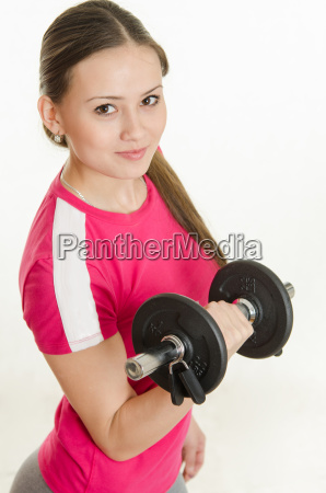 girl athlete looking up holding a