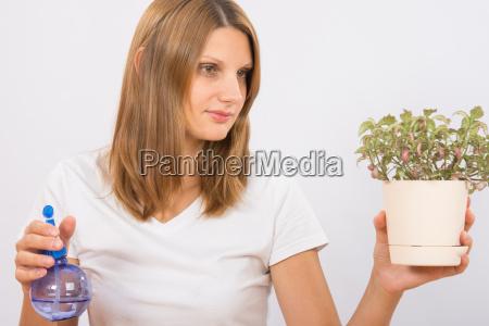 sie, hält, die, topfpflanzen, vor, der - 14923371