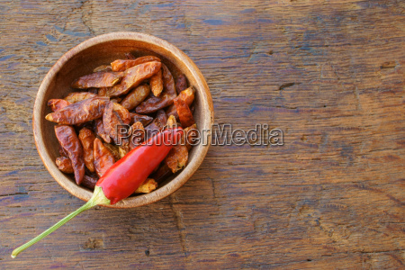 dried chillies in wooden bowl