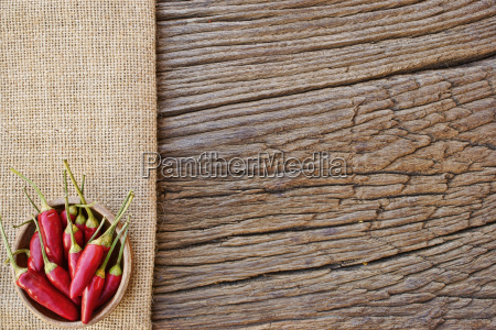 bowl with chillies on jutestoff on