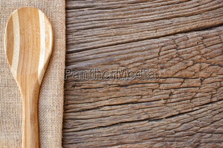 wooden spoon on hessian cloth as