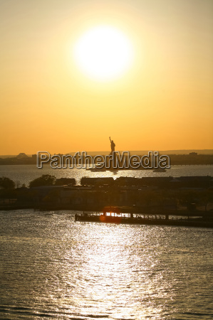 liberty statue and sunset in new