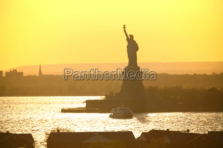 liberty statue on sunny day