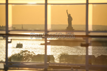 view of liberty statue through glass
