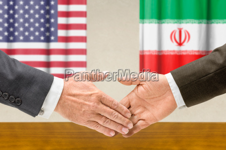 us and iranian officials shake hands