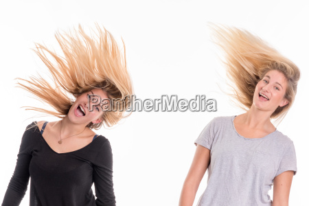 2 blonde girls shake their hair