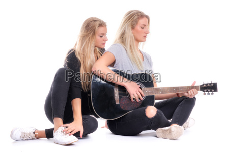 blonde girl listening to her sister