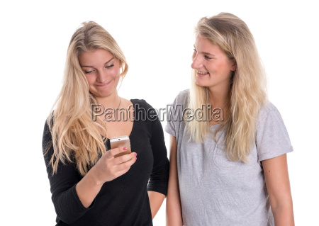 two blond girlfriends look together at