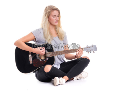 young girl sitting cross legged and
