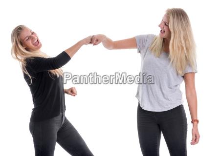 2 sister holding together