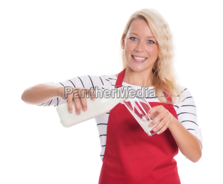 woman in red apron pours a