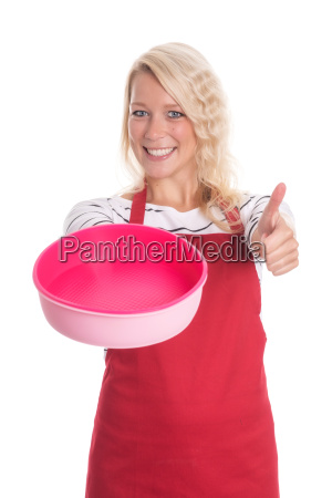 woman in apron holding a silicone