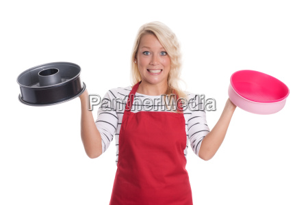 housewife holding different baking molds and