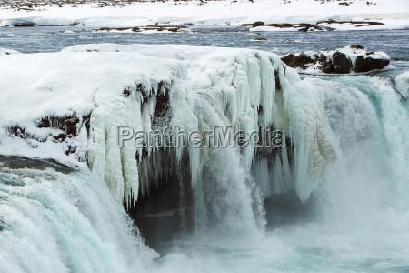 nahaufnahme des gefrorenen wasserfall godafoss island