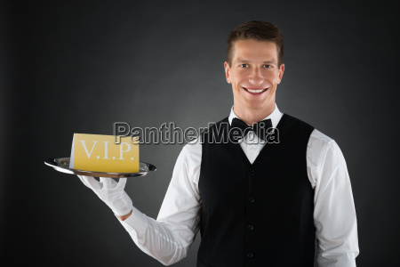 waiter showing vip sign