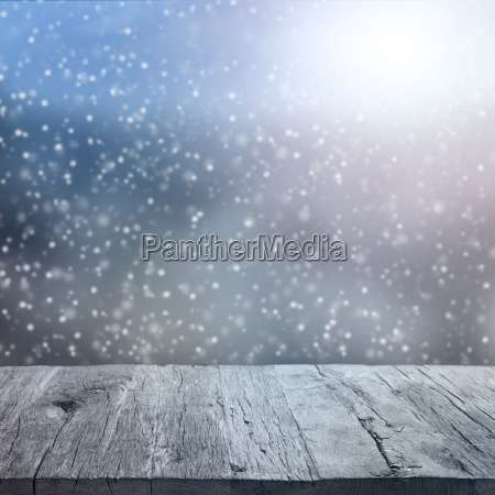 wooden table with winter background