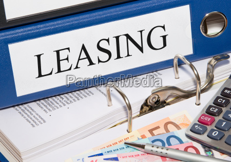 leasing folder with money in the