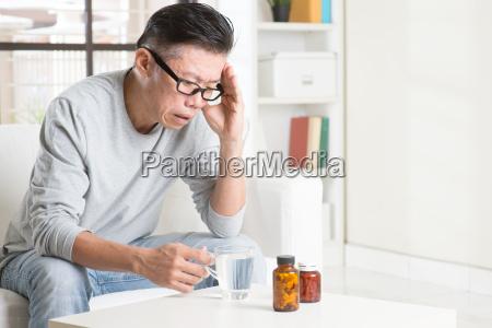 mature asian man headache