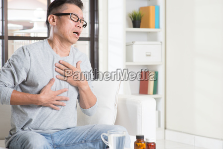 mature asian man heartpain