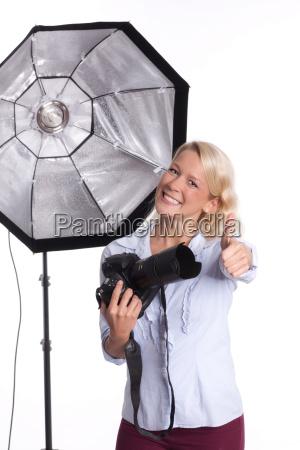 photographer in photo studio showing thumbs