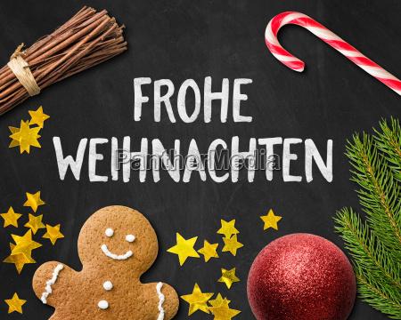 weihnachtskarte mit lebkuchenmann und weihnachtsdeko