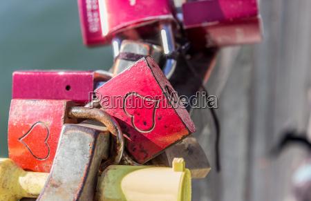 padlocks with hearts on a bridge