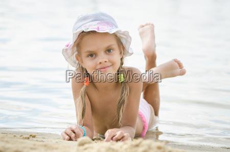 six year old girl lying on
