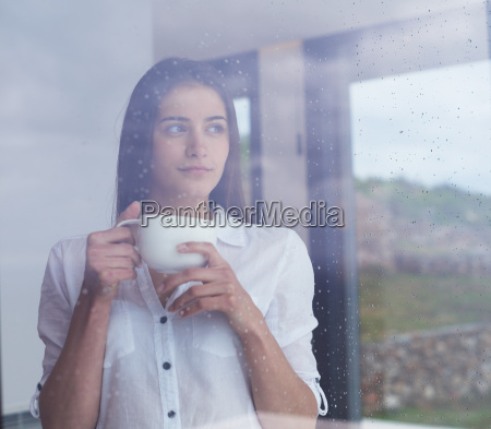 beautiful young woman drink first morning