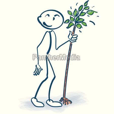 stick figure with tree