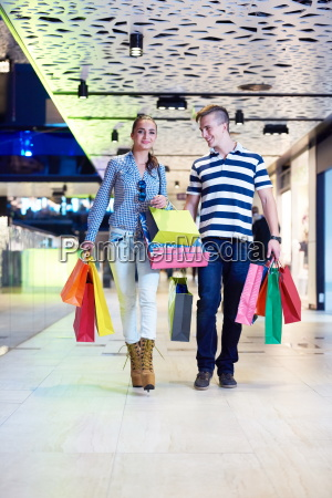 young couple with shipping bags