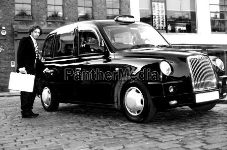 male passenger opening cab door