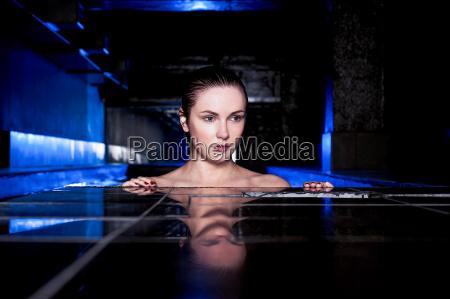 beautiful woman in a jacuzzi bathtub