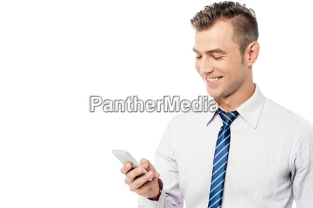 businessman reading a funny sms