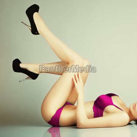 sexy glamour pose girl lying on