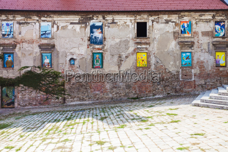 neglected house with mural paintings in