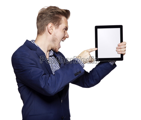 angry young man pointing at tablet