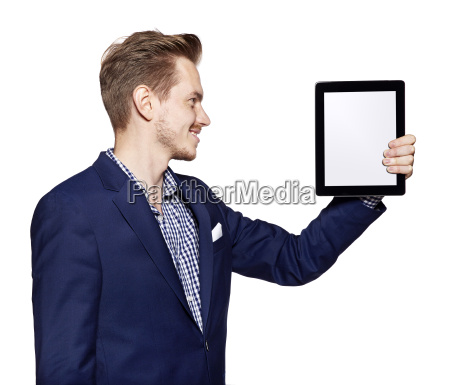 young man is looking at digital